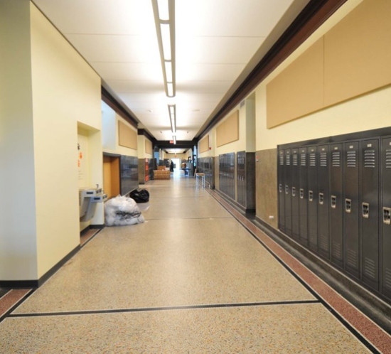 If you remember how loud corridors were during changing periods, you understand why deadening sound was an important part of the Independence Middle School rehab.  Rosin Preservation worked closely with the design team to find an appropriate solution that used ceiling clouds and acoustical wall panels to cover ductwork and quiet the hard historic surfaces without compromising historic character.